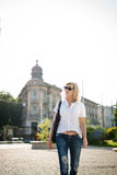 Stylish mature woman in casual outfit, outdoor shot. Royalty Free Stock Photography