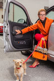 Stylish mature woman with her dog Stock Photos