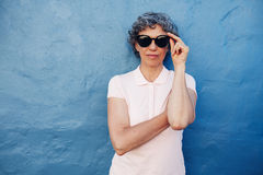 Stylish mature woman with sunglasses Stock Images