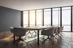 Stylish meeting room. Interior with panoramic city view, furniture, laptop on desktop and daylight. Toned image. 3D Rendering stock illustration