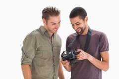 Stylish men looking at digital camera Royalty Free Stock Photos