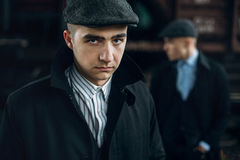 Stylish men portrait in retro clothes posing on background of ra Stock Images