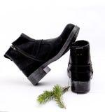 Stylish men`s black boots isolated on white. Picture of a Stylish men`s black boots isolated on white Royalty Free Stock Photo