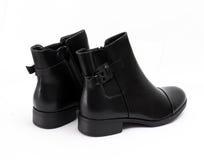Stylish men`s black boots isolated on white. Picture of a Stylish men`s black boots isolated on white Stock Photo