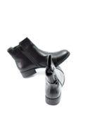 Stylish men`s black boots isolated on white. Picture of a Stylish men`s black boots isolated on white Stock Photography