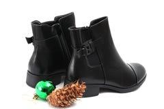 Stylish men`s black boots isolated on white. Picture of a Stylish men`s black boots isolated on white Stock Image