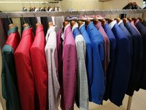 Stylish men`s clothes in shop. Colorful blazers Royalty Free Stock Image