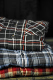 Stylish men's clothing, shirts folded in a pile Royalty Free Stock Photos