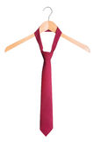Stylish men's fashion tie on a hanger. On a white background. Royalty Free Stock Photography