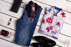 Stylish men's set of wear. Beautiful fashion men's clothing on a white wooden background. Stylish men's set of wear Royalty Free Stock Photo