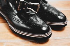 Men`s shoes and belt Stock Photography