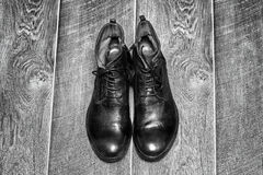 Stylish men's shoes. On a wooden background Royalty Free Stock Images