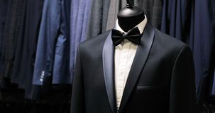 Stylish men`s suit. Men`s jacket on a mannequin. Men`s Clothing. Clothing store. Shopping in boutiques. Men`s Clothing. Mannequins in the boutique. Clothing stock video