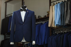 Stylish men`s suit. Men`s jacket on a mannequin. Men`s Clothing. Mannequins in the window of the boutique. Clothing store. Shoppin Royalty Free Stock Photo