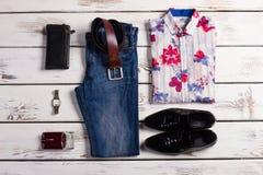 Stylish men set. Fashionable men's clothing on a white wooden background. Stylish men set Royalty Free Stock Images
