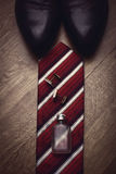 Stylish mens business accessories tie cologne cuff links Royalty Free Stock Image