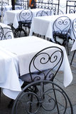 Stylish metal chair and tables at the restaurant Royalty Free Stock Photo