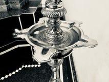 Stylish metallic Hindu religious object stock photo. A beautiful metallic diya stand Hindu religious isolated object unique photograph stock photo