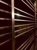 Stylish metallic interior protection grill object photograph. A brown steel made lines of a protection grill of a house interior unique photograph Royalty Free Stock Photo