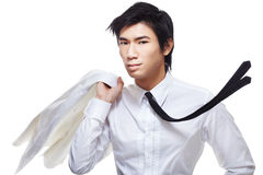 Stylish, metrosexual, handsome, hunky Chinese man. Fashionably stylish, good looking metrosexual Chinese model dressed in all white. Shot with a sense of motion Stock Images