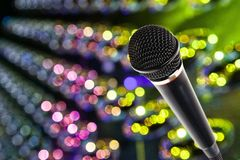 Stylish microphone on colored background Stock Image