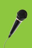 Stylish microphone on green background Stock Images