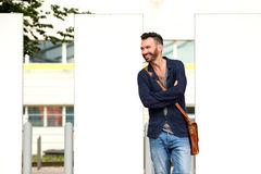Stylish middle aged guy standing outdoors on the city street Stock Photo