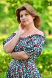 stylish middle-aged woman in the summer park Stock Photography