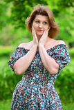 stylish middle-aged woman in the summer park Royalty Free Stock Photo