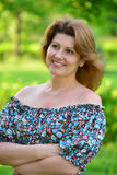 stylish middle-aged woman in the summer park Royalty Free Stock Photos