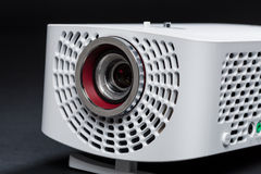 Stylish mini home cinema LED projector, lightweight tech gadget. Close up Royalty Free Stock Images