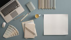 Stylish minimal office table desk. Workspace with laptop, notebook, pencils, coffee cup and sample color palette on pastel blue ba. Ckground. Flat lay, top view royalty free stock photo