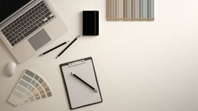 Stylish minimal office table desk. Workspace with laptop, notebook, pencils and sample color palette on white background. Flat lay royalty free stock photography