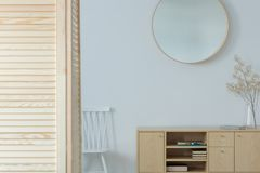 Stylish mirror on the wall of elegant corridor. With wooden furniture, real photo with mockup stock photography
