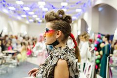 Stylish model with an author`s hairstyle. Cosplay character. Gomel, Belarus - March 24, 2018: International festival of hairdressers. Stylish model with an Stock Image