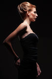 Stylish model in darkness Royalty Free Stock Images