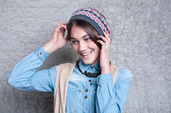 Stylish model in a knitted hat Stock Image