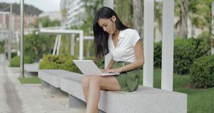 Stylish model with laptop on nature stock video footage