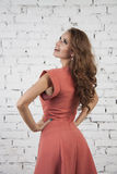 Stylish model in luxurous pink dress Stock Photography