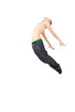Stylish modern ballet dancer jumping. Young and stylish modern ballet dancer jumping on white background Stock Image
