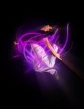 Stylish modern ballet dancer jumping 2. Stylish modern ballet dancer jumping on black Royalty Free Stock Photography