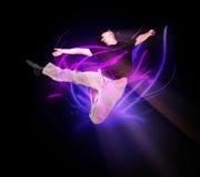 Stylish modern ballet dancer jumping 3. Stylish modern ballet dancer jumping on black Royalty Free Stock Photos