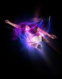 Stylish modern ballet dancer jumping 4. Stylish modern ballet dancer jumping on black Royalty Free Stock Image