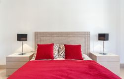 Stylish modern bedroom with bed and red pillows. Stylish modern bedroom with a bed and red pillows Stock Photos