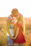 Stylish and modern couple kissing in the field.  Stock Images