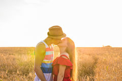 Stylish and modern couple kissing in the field.  Royalty Free Stock Photo