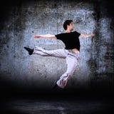 Stylish modern dancer posing 2. Stylish modern dancer posing on instrustrial backround 2 royalty free stock image