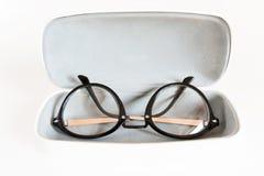 Stylish modern fashionable elegant black eyeglasses in white lea. Ther case. Indoors horizontal close-up image Stock Image