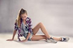 Stylish Modern Female Dancer Sitting on the Floor Stock Images