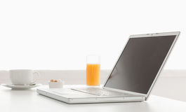 Stylish and modern laptop on a table Royalty Free Stock Photography